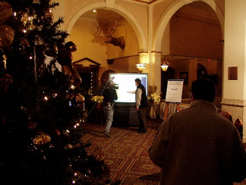 A pic of Jeff Hutcheson using the SMART Board(TM) interactive whiteboard during a live broadcast from the lobby of the Chateau Lake Louise