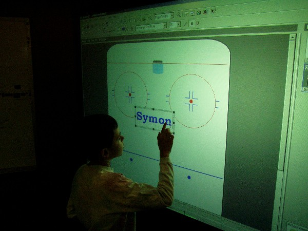 Symon working on the SMART Board(TM) interactive whiteboard